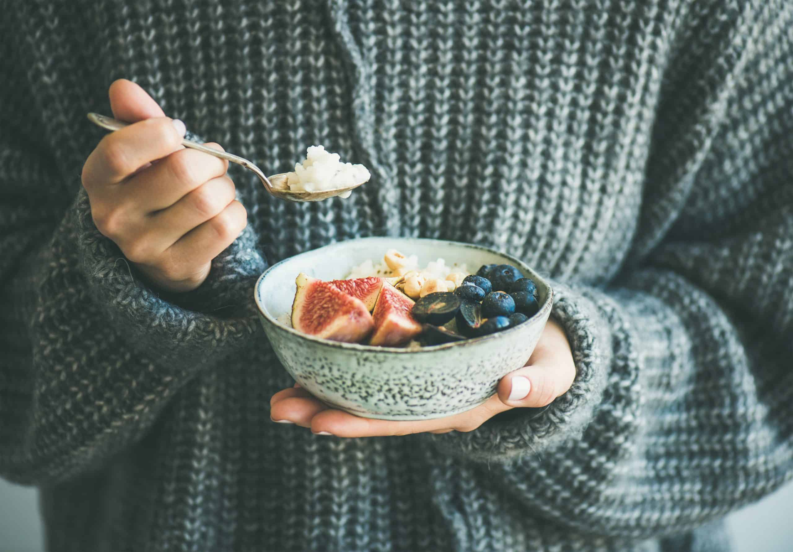 A women holding a bowl of healthy ultimate snack
