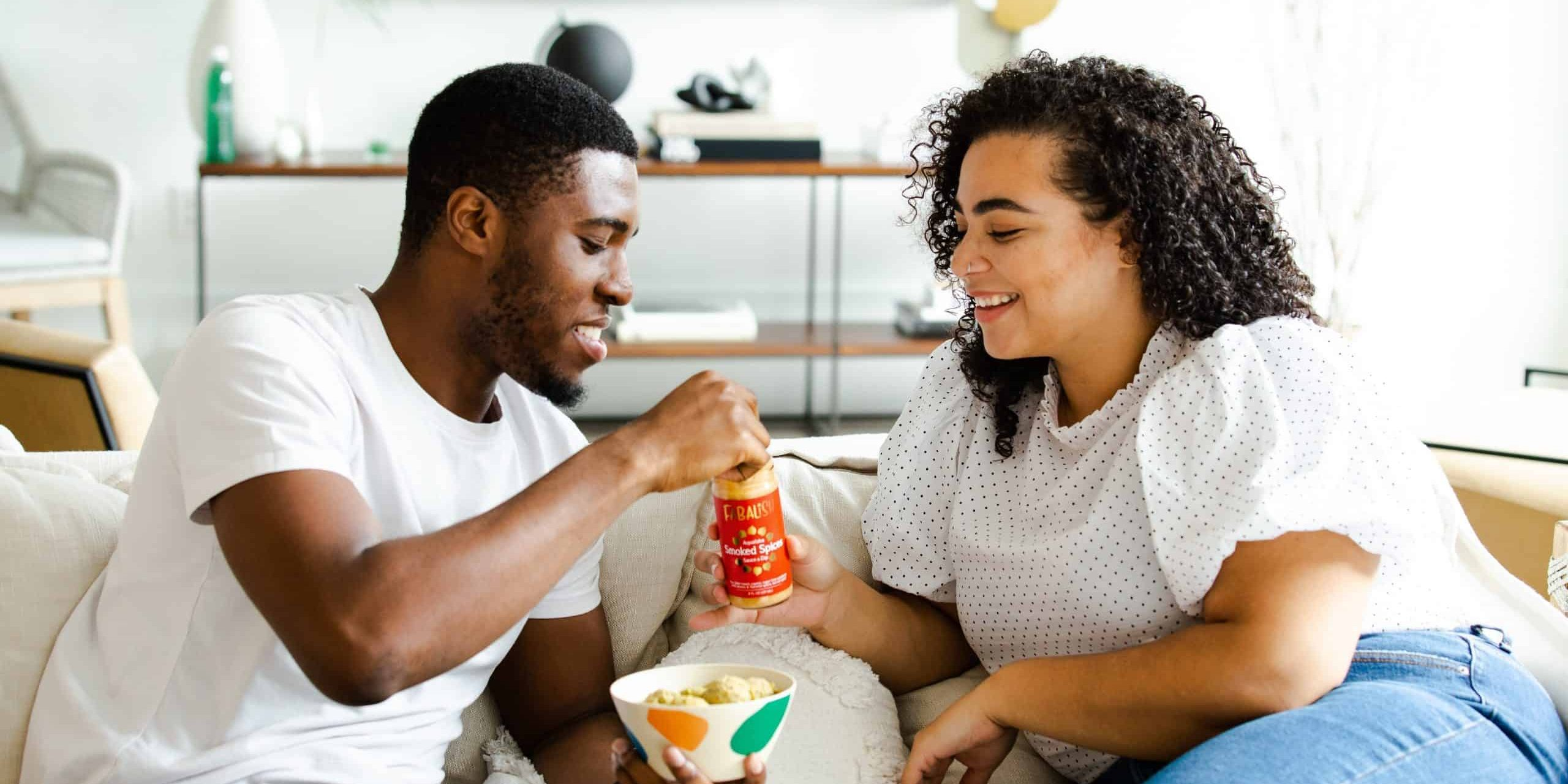 Two person Eating Snacks