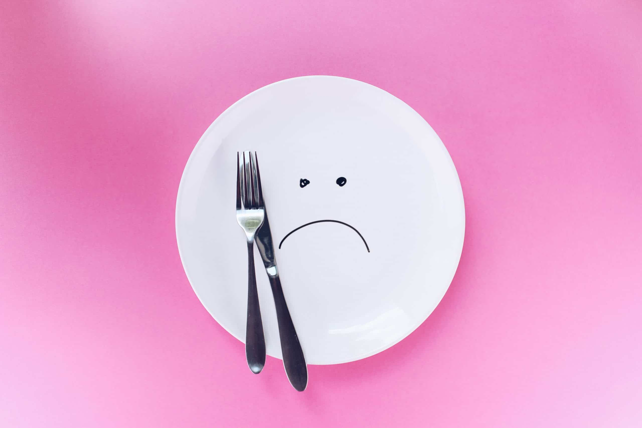 Sad face on plate is how we feel about the fad diet that is the keto diet