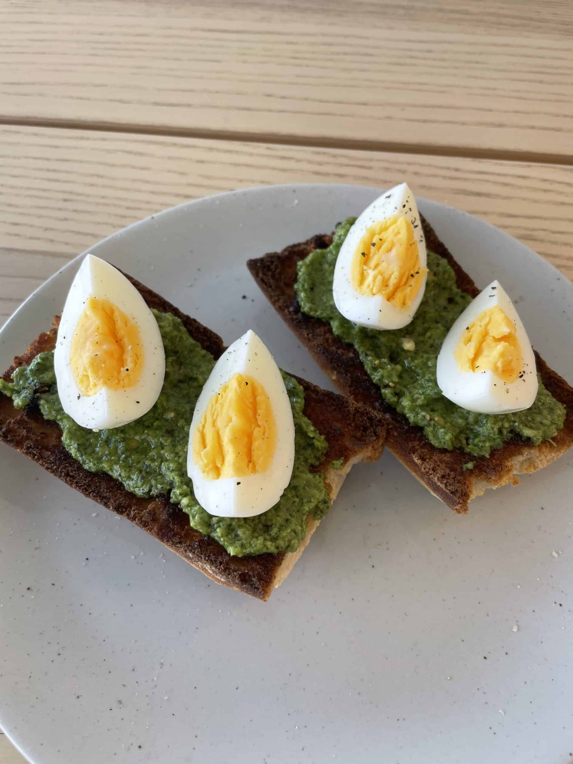 toast with basil and spinach healthy pesto and hard-boiled eggs
